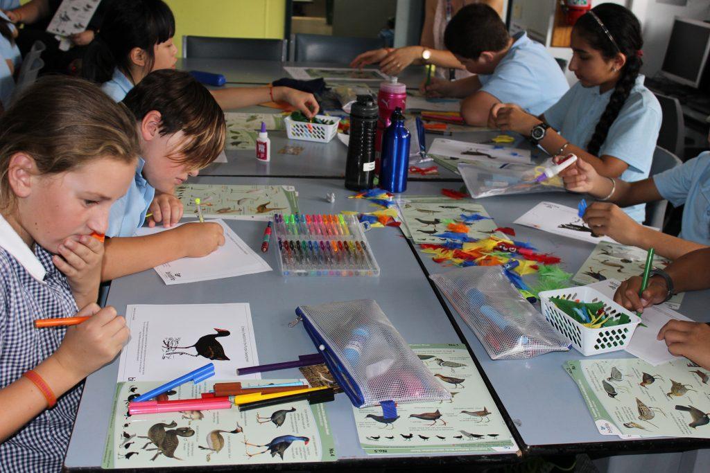 Children drawing birds